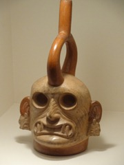 15 Water vessel pottery with skull sculpture