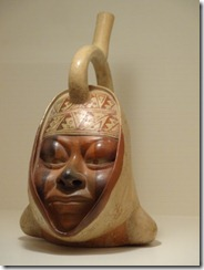 16 Woman's head pottery water vessel
