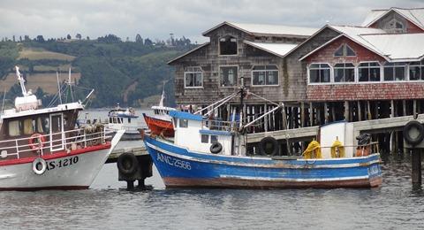20 Palafito restaurant with boats