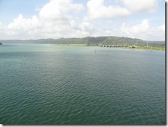 Dam of Chagres river near Gatun.  Far shore is a manmade earthen dam, half a mile thick at its base