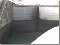 entering lock at Gatun, dark part of lock doors will be underwater when ready to move to next level