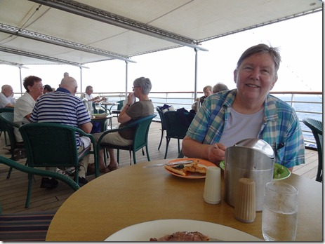 Mary eating on aft dining veranda