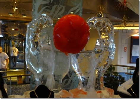 01 Ice sculpture of hands holding globe with Antarctica at center
