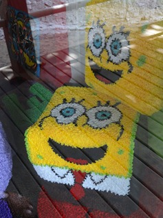 12 Spongebob rugs in store window