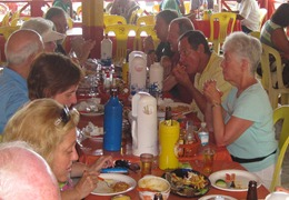 40 Rick & Mary (farthest away) & others eating at Boa Viagem beach