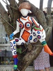 46 sculpture of woman, in tree