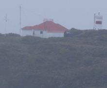 59 Lighthouse with house in Chilean fjords
