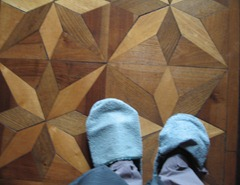 37 slippered feet on floor of Teatro salon