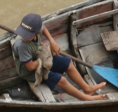 43 Kid with sloth in boat near ship