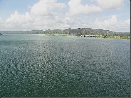 Dam of Chagres river near Gatun.  Far shore is a manmade earthen dam, half a mile thick at its base